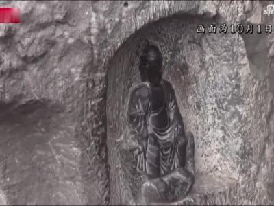 龙门石窟佛像被摸出包浆 景区紧急加装铁网